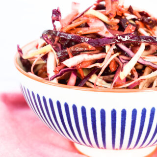 A balsamic beet coleslaw with no mayo in a bowl
