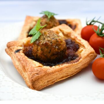A square falafel onion pie with cherry tomatoes