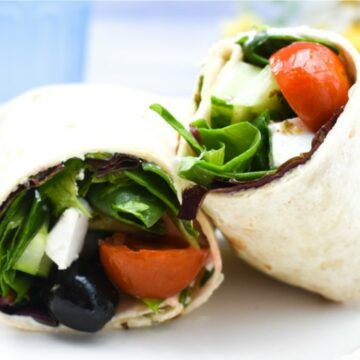 Vegan Greek Salad Lunch Wrap on a white plate