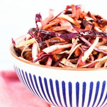 Balsamic beet slaw in a stripy bowl
