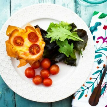 Vegan Cheese Red Pepper Filo Hand Pie with salad leaves and cherry tomatoes