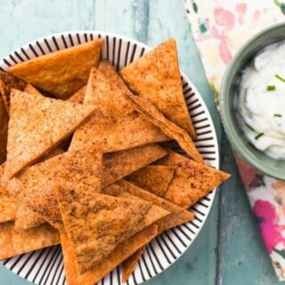 Homemade paprika tortilla chips with dip