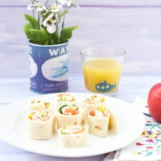 Kids pinwheel sandwiches on a white plate