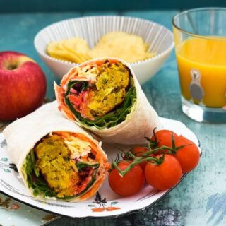 Onion Bhaji Lunch Wrap served with cherry tomatoes