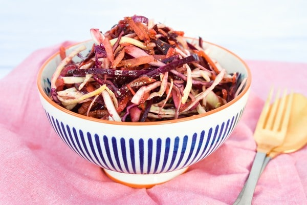 Balsamic beetroot coleslaw in a stripy bowl
