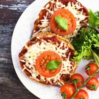 Vegan sesame bagel pizza with salad