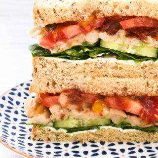Vegan Italian White Bean & Tomato Sandwich on a patterned plate