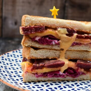 Vegan Reuben Sandwich with Russian Dressing on a patterned plate