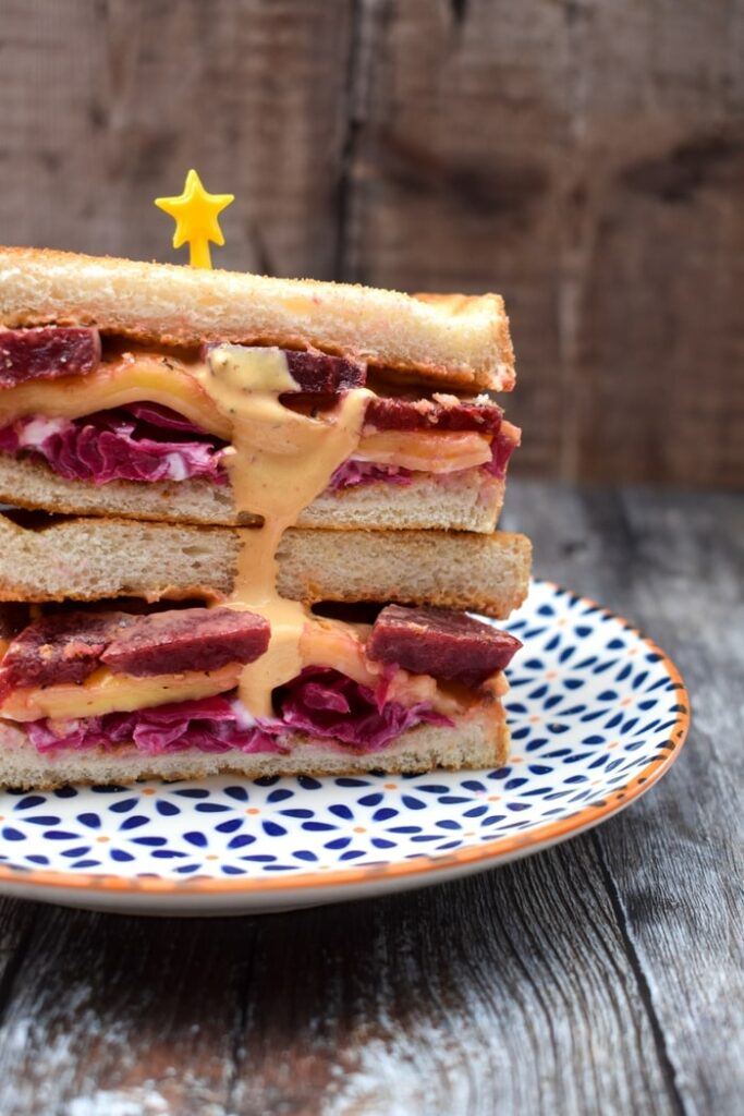 Reuben Sandwich stacked on a patterned plate