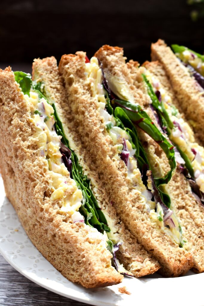 close up of a cheese and onion salad sandwich
