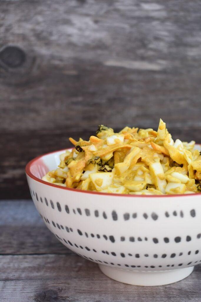Vegan coronation coleslaw in a white bowl