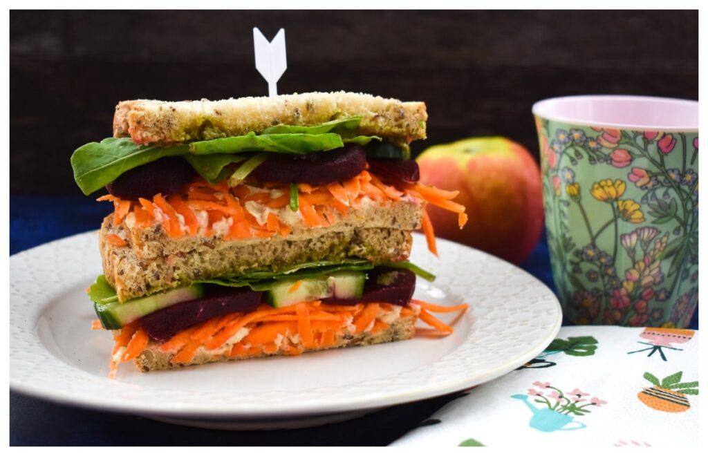 vegan hummus beet sandwich cut in half and stacked