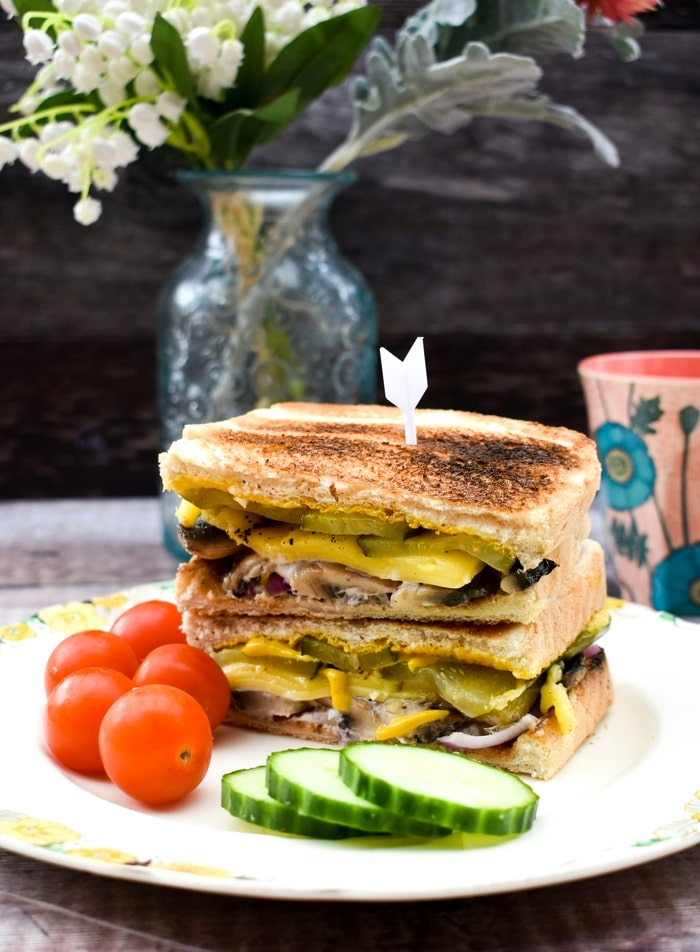 Toasted Vegan Cuban Sandwich served with cherry tomatoes and cucumber