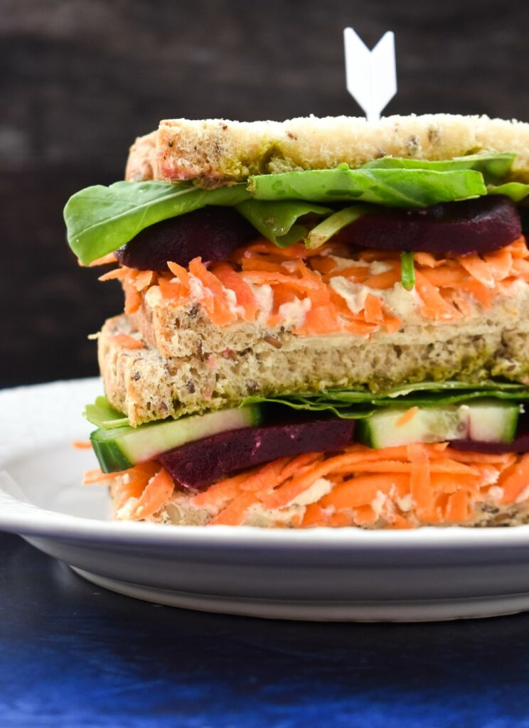 a stack of hummus beet sandwiches