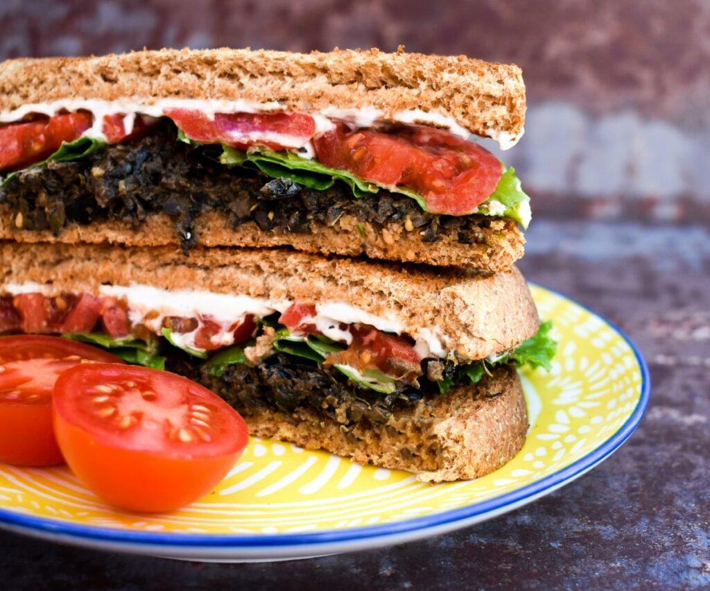 olive tapenade and tomato sandwich