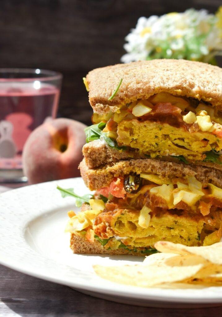 onion bhaji sandwich stacked on a plate